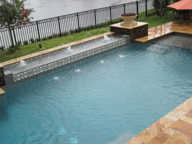geometric pool with water feature