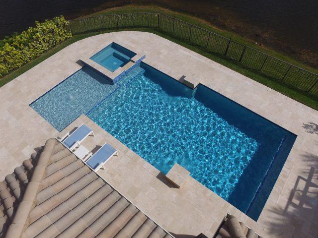 Geometric swimming pool South Florida in back yard