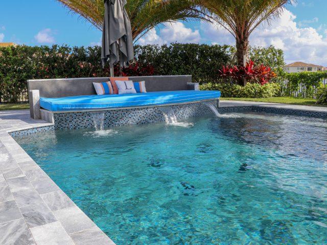 Pool sofa on edge of rectangular pool
