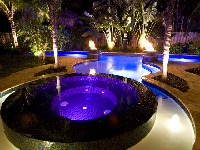 hot tub and elegant swimming pool at night time Florida